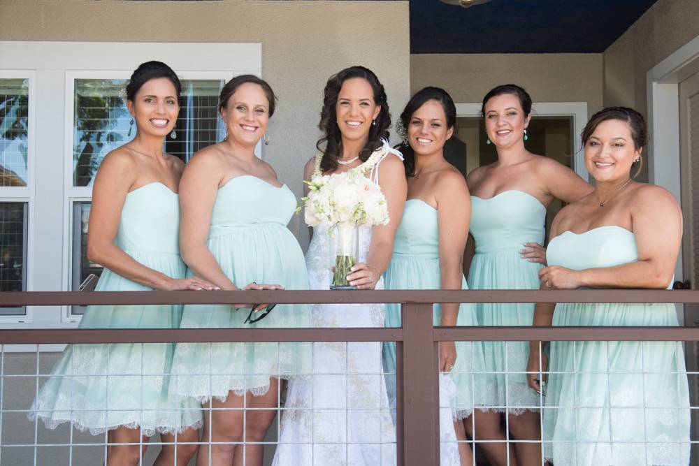 Bridal party standing on lanai