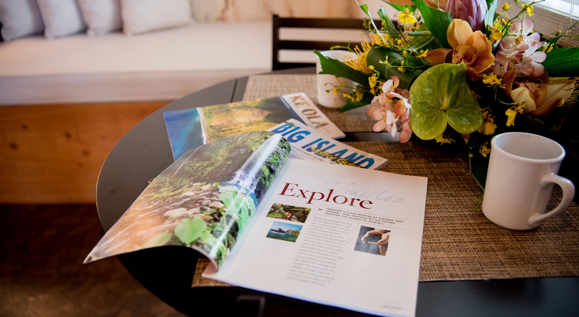table with magazines and flower center piece
